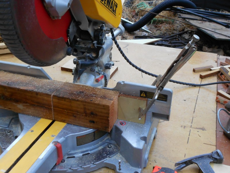 Setting the chop saw up for multiple cuts.