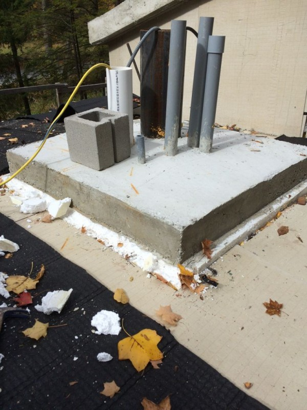 Chimney base with styrofoam exposed.