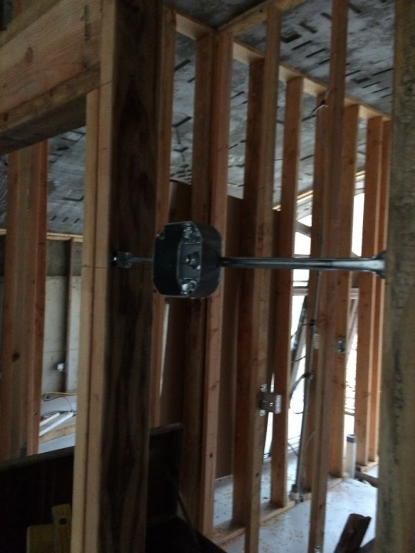 Octagonal wall mounted box for a lighting fixture.