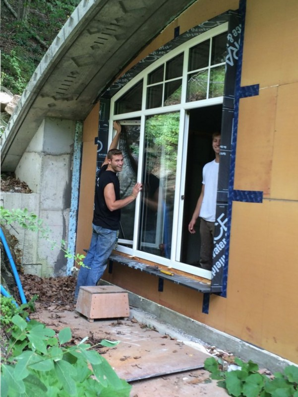 Jude and Ethan removing the protective coating stuff off the window.